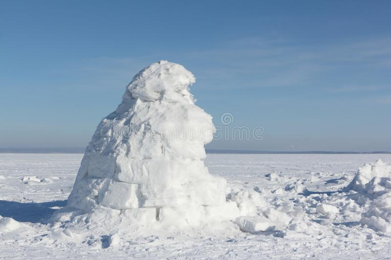 Igloo standing on a snowy glade. In the winter stock images