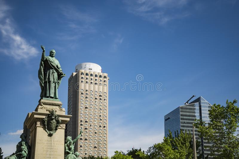 The Ignace Bourget Monument in Montreal in Quebec, Canada. The Ignace Bourget Monument is a monument of Louis-Philippe Hebert located in front of Montreal`s stock photo