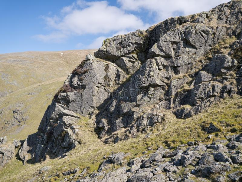 Igneous rock outcrop near Helvellyn, Cumbria, UK royalty free stock photos