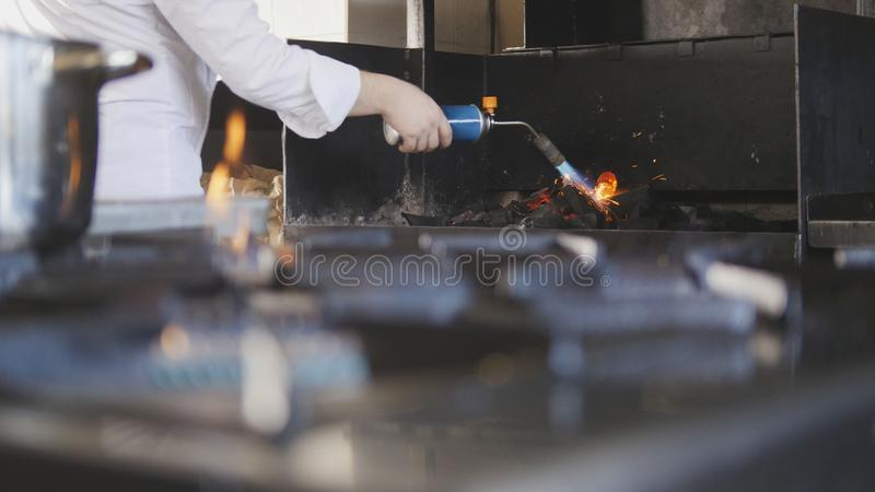 Ignition of charcoal in the barbecue oven stock photography