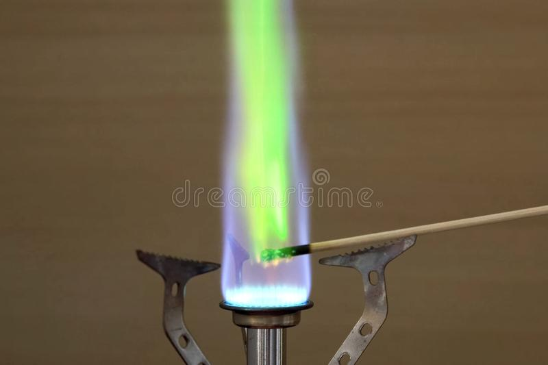Ignition of copper oxide on a mini burner with stick. on the mini burner. Chemical experiments. Ignition of copper oxide on a mini burner with a wooden stick. on royalty free stock photography
