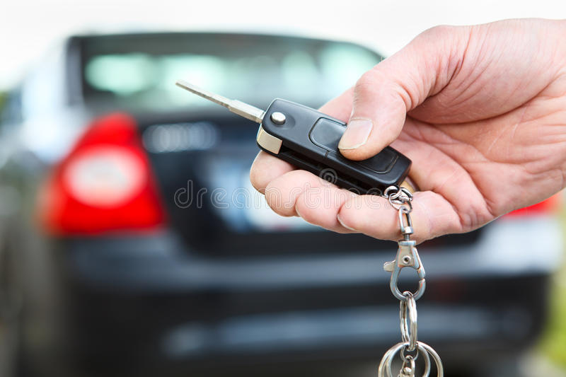 Ignition Key With Remote Control In Hand Royalty Free Stock Photography