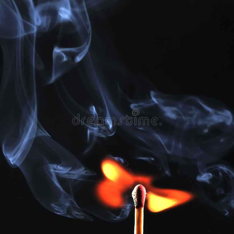 Ignition of match with smoke, isolated on black background stock photo