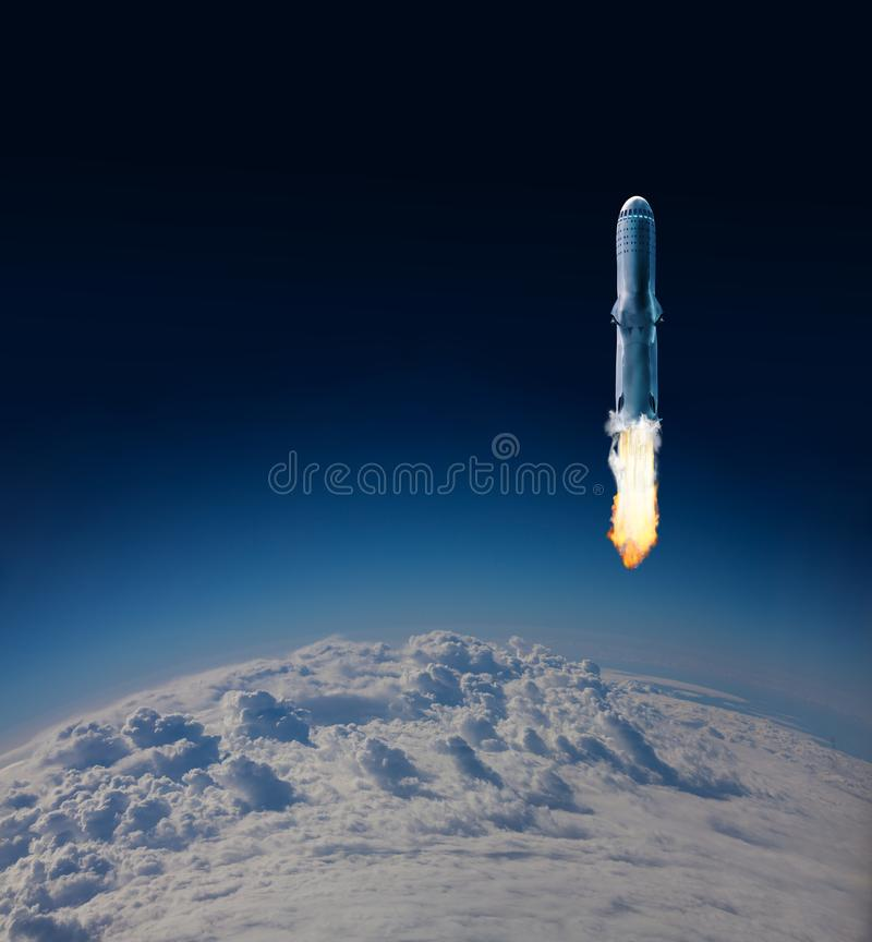 Ignition of Rocket first stage over Earth clouds stock photo