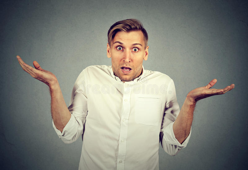 Ignorance arrogance. man shrugging shoulders who cares I don't know royalty free stock photography