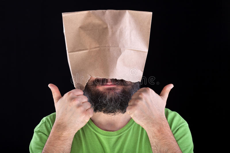 Ignorance is bliss - man likes his eyes and head being covered. Taking the easy road concept stock image