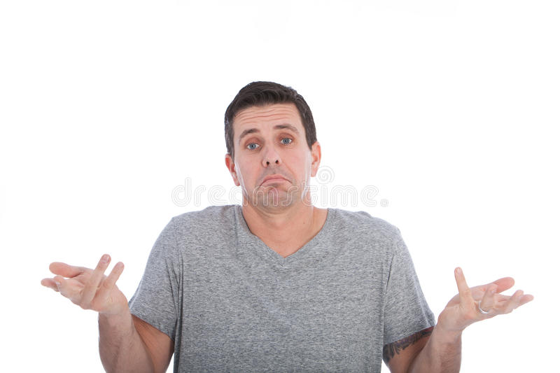 Ignorant man giving a dismissive shrug stock images