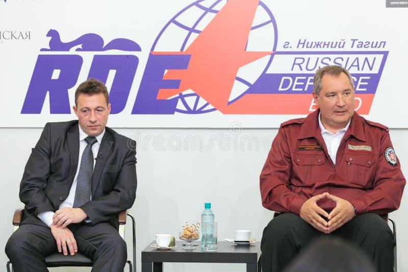 Igor Kholmanskikh en Dmitry Rogozin stock foto's