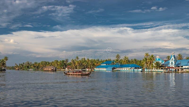 Igreja azul com casas flutuantes imagens de stock royalty free