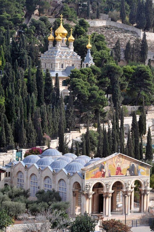 Igreja de todas as nações e de St Mary Magdalene Church na montagem de imagem de stock