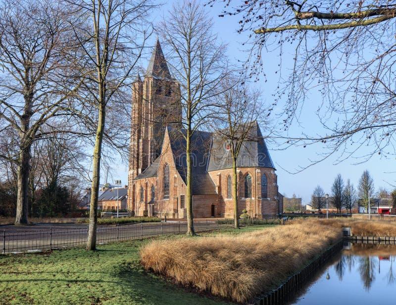 A igreja do Saint Michel na aurora ensolarada, embaraça, Flanders, Bélgica foto de stock