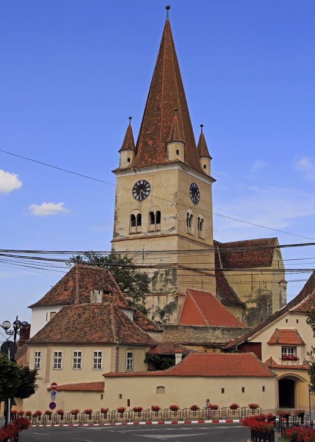 Igreja evangélica fortificada na cidade Cisnadie perto de Sibiu imagem de stock royalty free