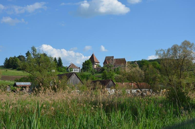 Igreja fortificada Alma Vii, Transilvania, Romênia foto de stock