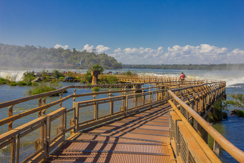 IGUAZU, ARGENTINA - MAY 14, 2016: bridge over the iguazu falls in the argentinian side of the national park.  royalty free stock images