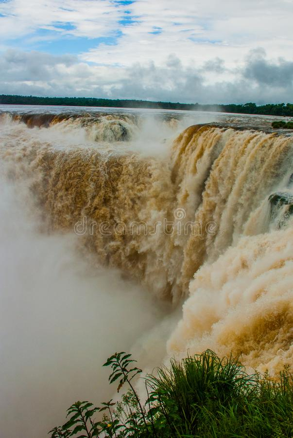Iguazu Falls on the border of Argentina and Brazil, view of Devil`s Throat waterfall, the largest in the Iguazu cascades system royalty free stock photography