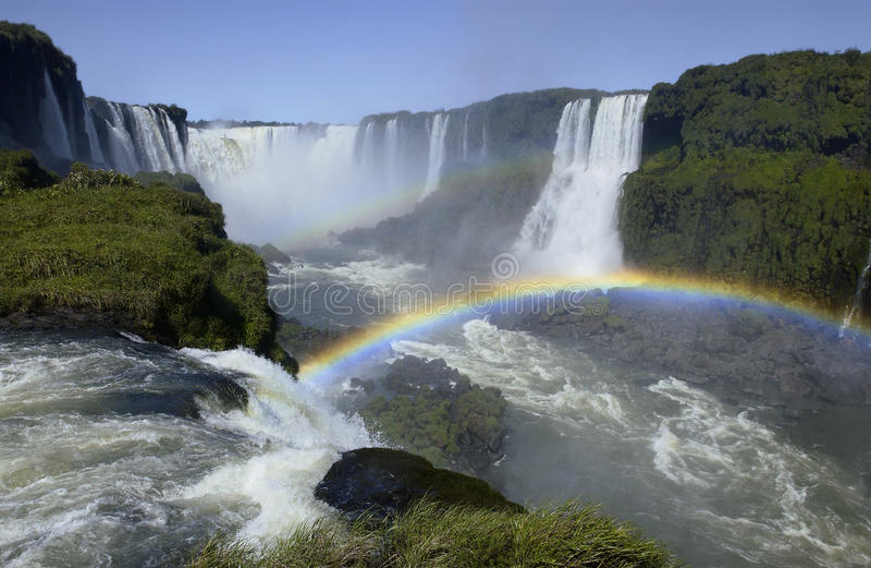 Iguazu Falls - Brazil / Argentine border. Rainbows in the spray of Iguazu Falls on the border of Brazil and Argentine stock images