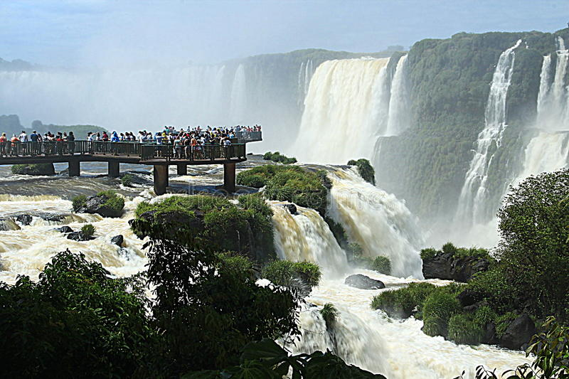 The Iguazu Falls - View from Brazil side. Iguazu Falls are waterfalls of the Iguazu River on the border of the Argentina province of Misiones and the Brazilian royalty free stock images