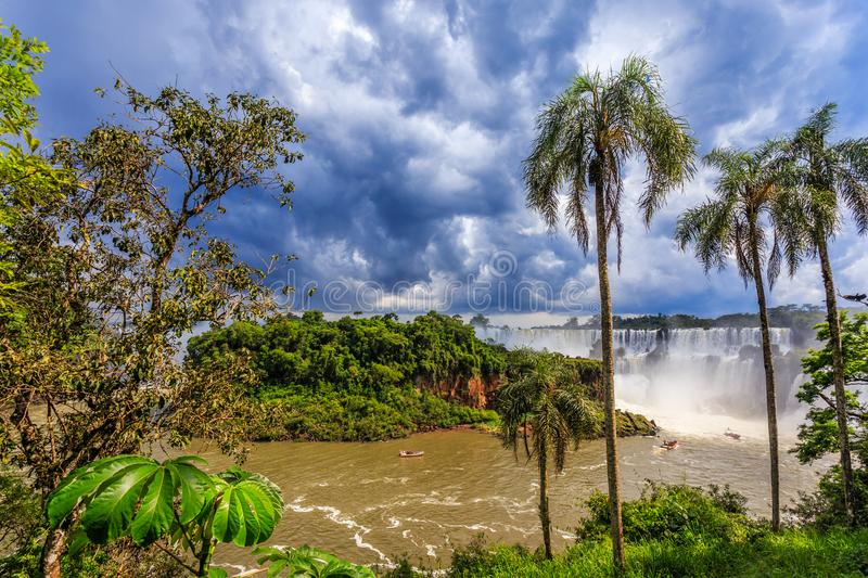 Iguazy Falls panorama view from the jungles with palms and cloud royalty free stock images