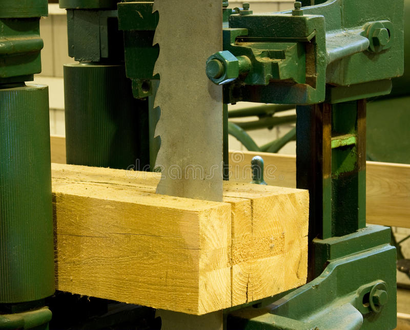 Ihdustrial band saw sawmill. Idustrial band saw cutting a log into boards royalty free stock image