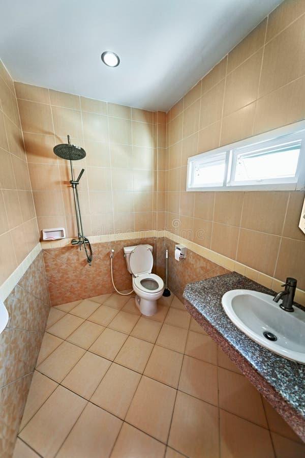 Iinterior of beige bathroom with shower