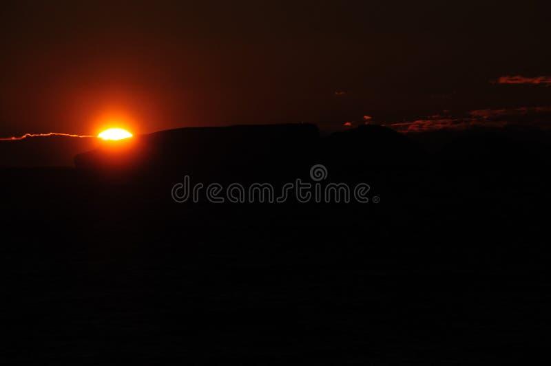 Ijsbergen in het avond licht stock afbeeldingen