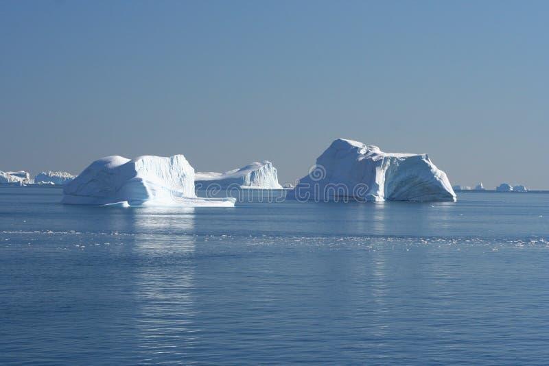 Ijsbergen van Groenland stock foto's