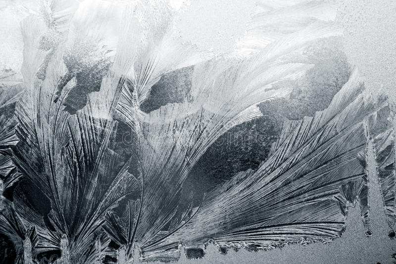 Ijsbloemen op glas royalty-vrije stock afbeeldingen