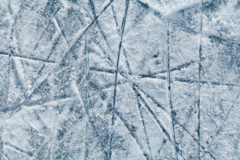 Ijshockeypiste met sporen van vleten stock fotografie