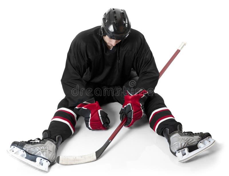 Ijshockeyspeler die teleurgesteld kijken royalty-vrije stock afbeelding