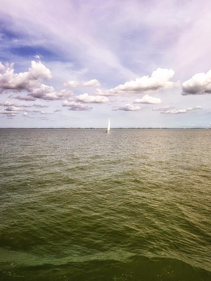 IJsselmeer, the Netherlands with in the distance Sailing ships. royalty free stock photography