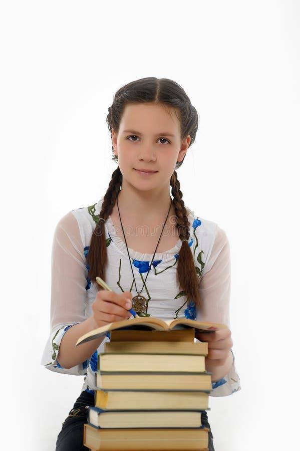 Ijverig schoolmeisje stock afbeelding