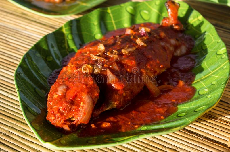 IKAN ASAM MANIS - typical Indonesian dish Fish in sweet & sour sauce.  royalty free stock photography