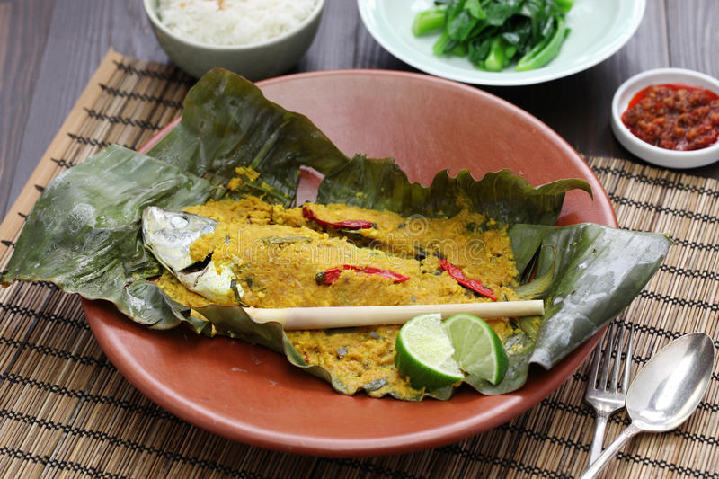 Ikan pepes, indonesian cuisine. Steamed fish wrapped in banana leaves stock images