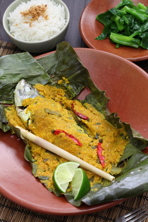 Ikan pepes, indonesian cuisine. Steamed fish wrapped in banana leaves royalty free stock photography
