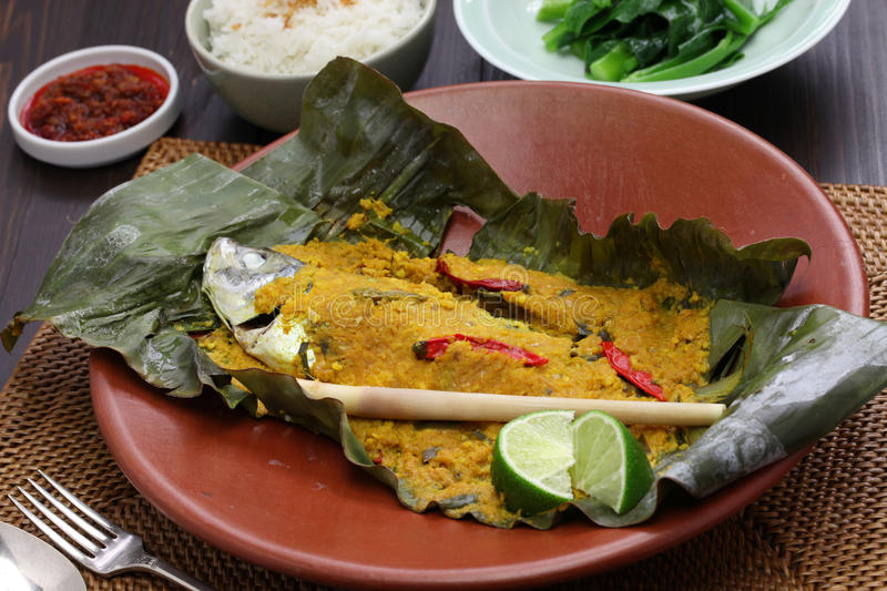 Ikan pepes, indonesian cuisine. Steamed fish wrapped in banana leaves royalty free stock photo