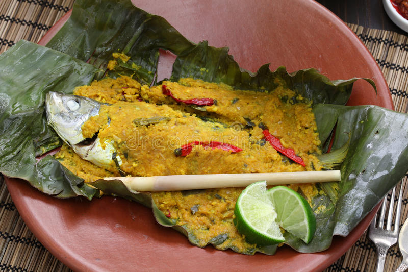Ikan pepes, indonesian cuisine. Steamed fish wrapped in banana leaves stock photography