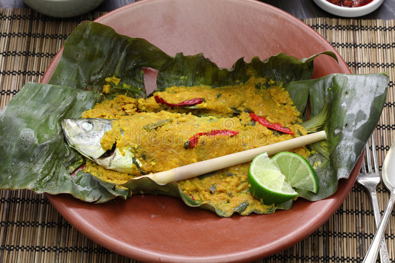 Ikan pepes, indonesian cuisine. Steamed fish wrapped in banana leaves royalty free stock image
