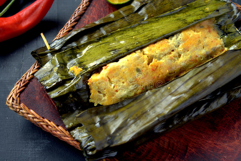 Ikan Pepes. Indonesian cuisine, steamed and grill fish wrapped in banana leaves stock photo