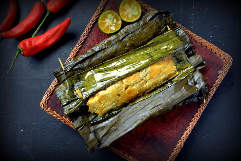 Ikan Pepes. Indonesian cuisine, steamed and grill fish wrapped in banana leaves stock photography