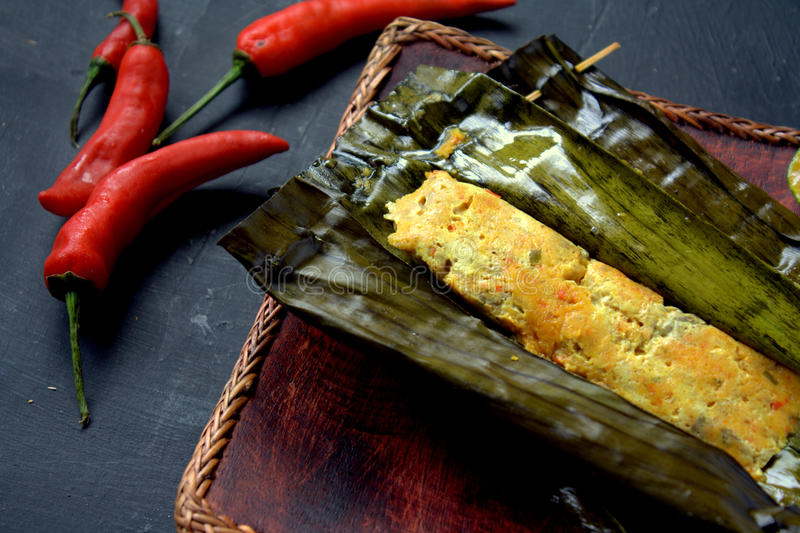 Ikan Pepes. Indonesian cuisine, steamed and grill fish wrapped in banana leaves royalty free stock images