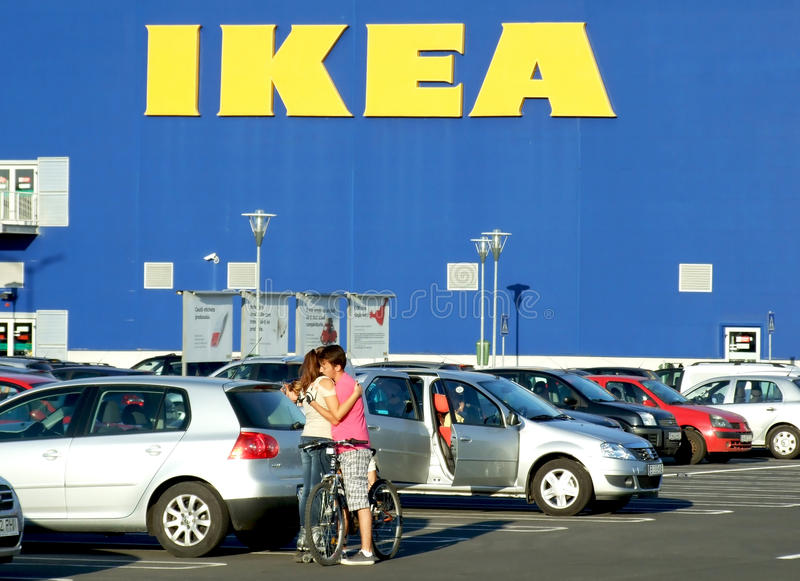 IKEA. A couple hugging in the parking of IKEA royalty free stock image