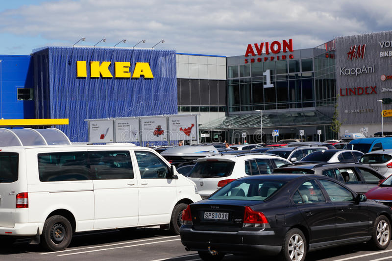 Ikea and Avion. Umea, Sweden - July 18, 2016: Parking space with parked cars infront of the shopping center with Ikea furniture store and the shopping mall Avion royalty free stock image