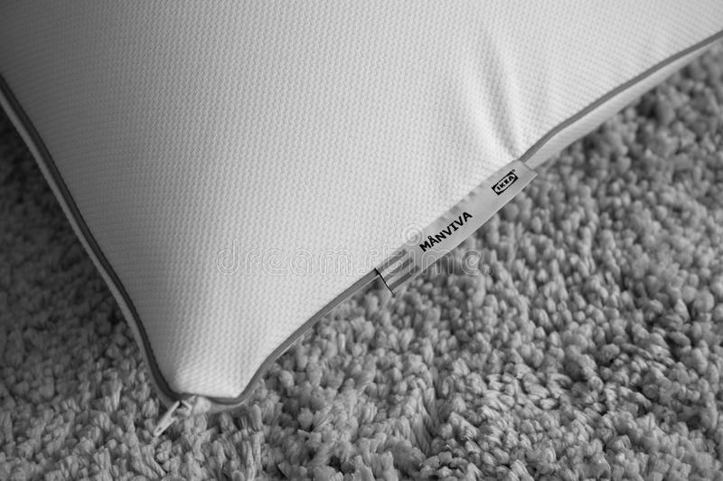 Ikea foam pillow. PARIS, FRANCE - JUN 4, 2016: IKEA Manviva foam pillow on home background - black and white stock photos