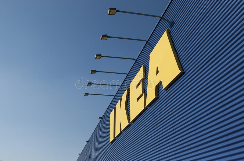 IKEA sign on Ikea market. IKEA owns and operates 351 stores in 46 countries. IKEA was founded in 1943 as a mostly mail-order sales business.It began to sell stock images