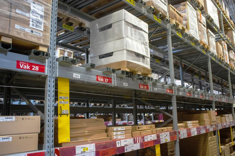IKEA warehouse in the IKEA store. Duiven, Netherlands - May 24, 2019: IKEA warehouse in the IKEA store to pick up the purchased goods royalty free stock photo