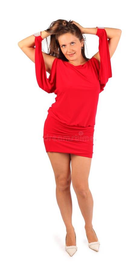 Iklädda klänningdanser för härlig kvinna i studio fotografering för bildbyråer
