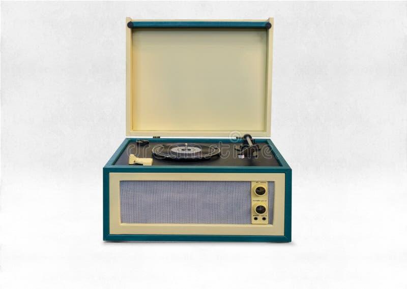 Ikonenhafter Kastenaltgold grüner 45s und 33s LP Rekordspieler mit errichtet in den Sprechern stockfoto
