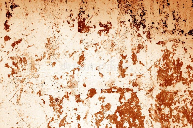 Il ¡ di Ð ha rastrellato la struttura stagionata della parete del cemento nel tono arancio fotografie stock