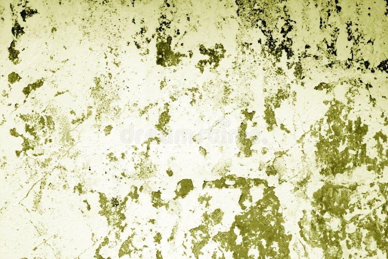 Il ¡ di Ð ha rastrellato la struttura stagionata della parete del cemento nel tono giallo immagini stock libere da diritti