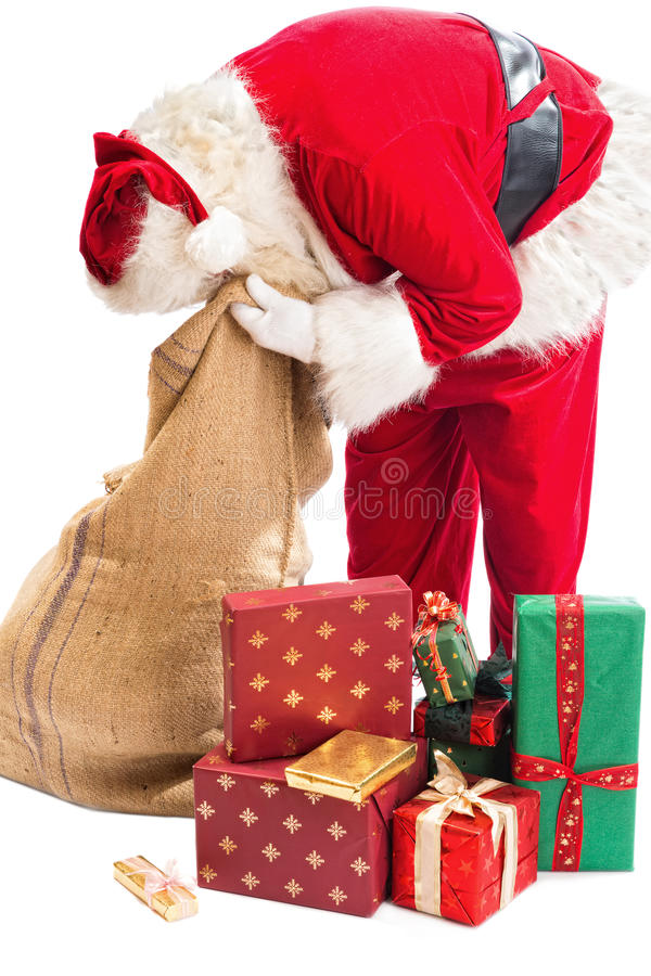 Il Babbo Natale che cerca un regalo fotografia stock libera da diritti
